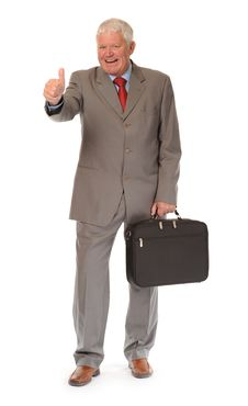 Successful Mature Businessman Giving Thumbs Up Stock Image