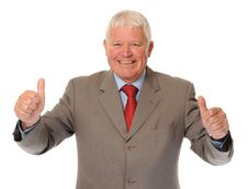 Successful Mature Businessman Giving Thumbs Up Stock Photography