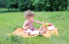 Small Lovely Girls With Fruits In The Park Royalty Free Stock Image