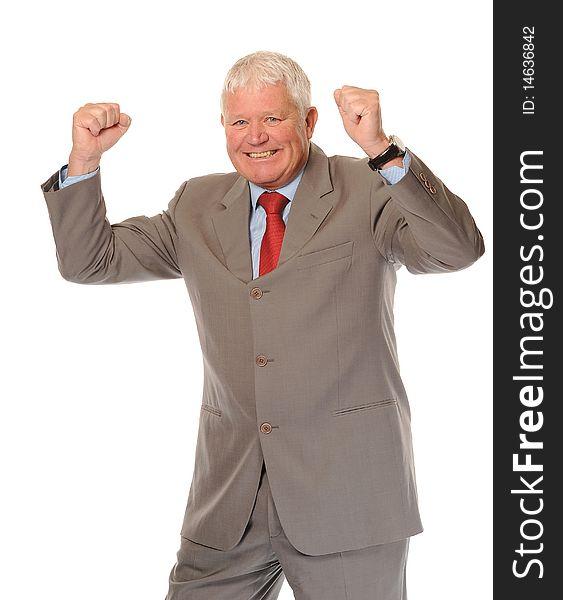 Successful mature businessman celebrating