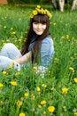 Free Girl Sitting Among Dandelions Royalty Free Stock Photography - 14642717