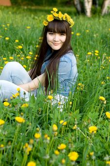 Girl Sitting Among Dandelions Royalty Free Stock Photography