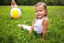 Girl And Her Mother Are Playing With Ball Royalty Free Stock Photos