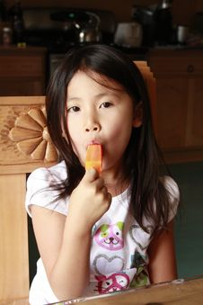 Free Asian Girl Eating Ice Pop Royalty Free Stock Photos - 14645658