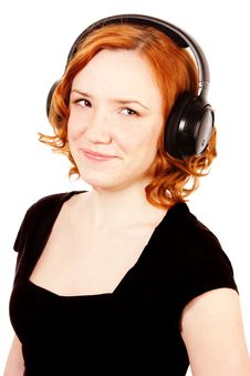 Free Redhead Girl Listening Music In Headphones Stock Photo - 14645780