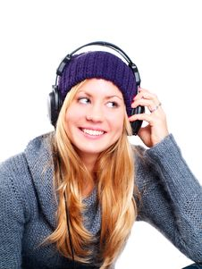 Woman With Headphones Listening Music Over White Royalty Free Stock Images