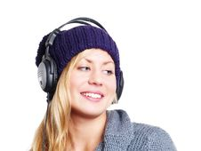 Woman With Headphones Listening Music Over White
