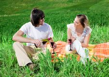 Girl And Boy With Wine On Grass Royalty Free Stock Photos