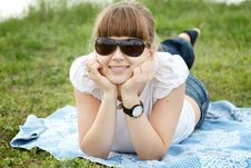 Free Cute Girl Lying On The Grass Royalty Free Stock Images - 14647029