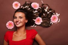 Woman And Gerbera Stock Image