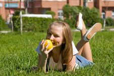 Free Teenage Girl With A Yellow Apple Royalty Free Stock Photo - 14650355