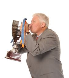 Free Successful Mature Businessman Holding Trophy Stock Images - 14651474