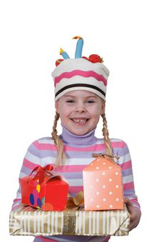 Girl In Cap-cake With Gift Boxes Royalty Free Stock Photos