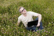 Free Man With Laptop On Meadow Stock Photos - 14651753