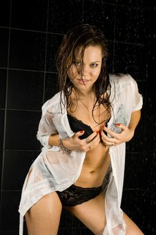 Sexy Wet Girl In Black Swimsuit And In White Shirt Royalty Free Stock Photography