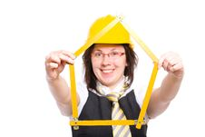 Free Female Builder Holds Measure In The Shape Of House Royalty Free Stock Photo - 14658675
