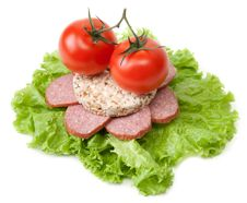 Sandwich With Sausage, Tomatoes And Salad Stock Photo