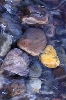 Free Coloured Pebbles In Running Water Royalty Free Stock Image - 14659276