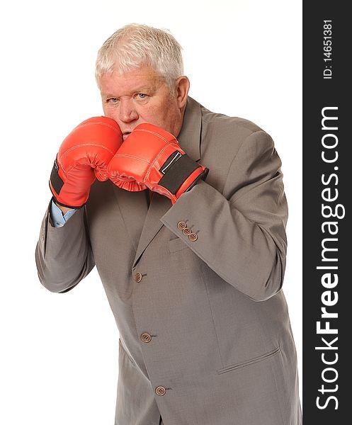 Successful mature businessman boxing