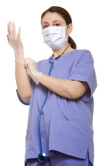 Doctor Putting Her Gloves On Royalty Free Stock Image