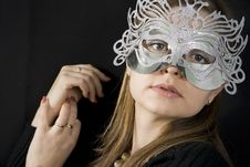 Free The Beautiful Woman With A Mask In The Face Of Royalty Free Stock Images - 14661069
