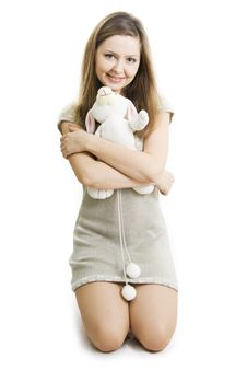 Young Woman Hugging Her Soft Toy. Royalty Free Stock Images