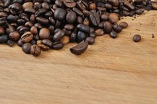 Free Coffee Granules On Wood Desk Stock Photos - 14662613