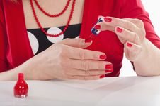 Woman Painting Nails Stock Images