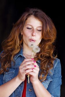 Girl Blowing On Two Dandelions Royalty Free Stock Photos