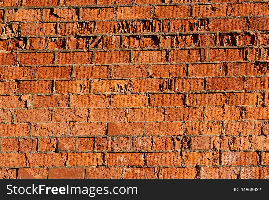 Destructive wall of red brick building