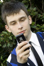 Free Teenager Looking At Mobile Phone Stock Photo - 14675280