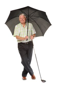 Free Happy Casual Mature Golfer With Umbrella Stock Image - 14672181