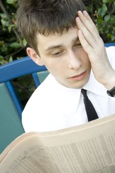 Free Young Man Reading Newspaper Stock Photos - 14675203