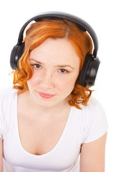 Redhead Gilr With Headphones Royalty Free Stock Image