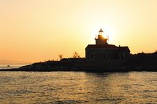Free Lighthouse At Sunset Royalty Free Stock Photo - 14676195
