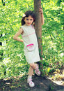 Free Little Girl Standing Near A Tree Stock Image - 14684621