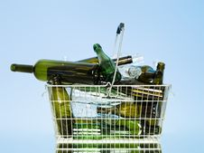 Glass Bottles In A Wastebasket Stock Images