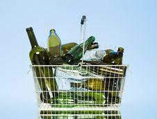Glass Bottles In A Wastebasket Stock Photo