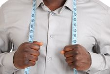 Free Black Business Man Wearing A Measuring Tape Stock Image - 14680481