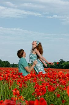 Free Loving Couple In A Field With Poppies Stock Images - 14680684