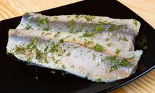 Herring On Black Plate Royalty Free Stock Photography