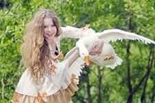 Free Girl Has Caught A Goose Royalty Free Stock Photos - 14687988