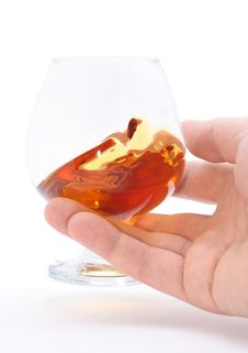 Free Glass Of Brandy Holding By Hand Stock Photos - 14688883