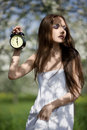 Free Young Girl With An Alarm Clock In The Meadow Stock Photography - 14698372