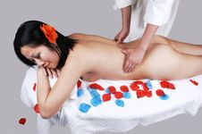 A Nude Chinese Girl Getting Massage. Stock Image
