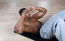 Free African American Doing Sit Ups And Crunches Stock Photography - 14694382