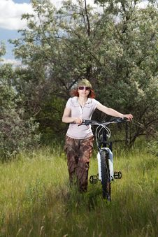 Free Woman Riding Bike Royalty Free Stock Image - 14695036