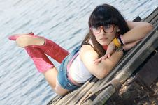 Free Sexual Brunette In Shorts Near Lake Stock Photo - 14697190