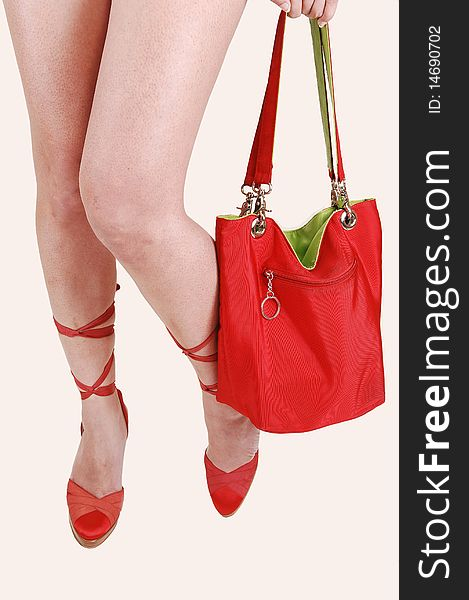 Girls legs with red bag.