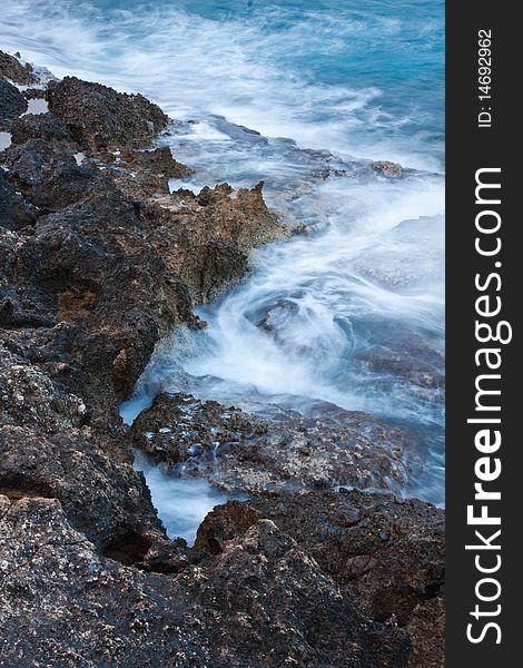 Waves crushing onto rocks